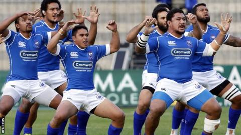 Samoa players perform the Siva Tau ahead of their international rugby test match against Italy