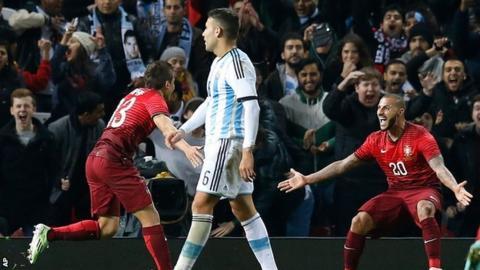 Ricardo Queresma and Raphael Guerreiro celebrate Portugal's winner against Argentina