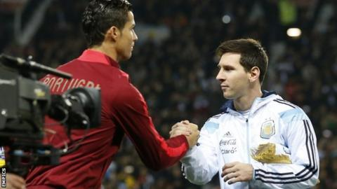 Cristiano Ronaldo and Lionel Messi shake hands before kick-off