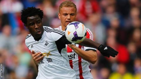 Wilfried Bony takes on Sunderland's Wes Brown