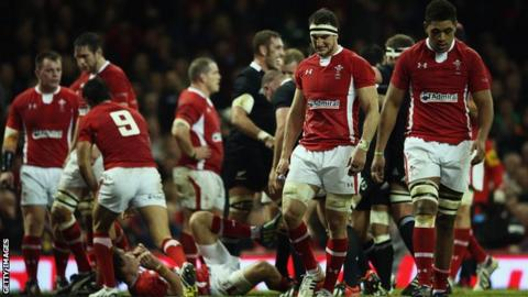 Wales players including captain Sam Warburton (second right) and Taulupe Faletau (right) are left dejected by against New Zealand in 2012