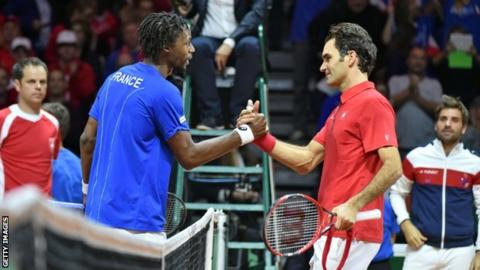 Gael Monfils (left) and Roger Federer