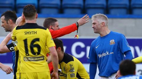 Glenavon defender William Murphy was sent off by referee Raymond Crangle during the first half against Cliftonville