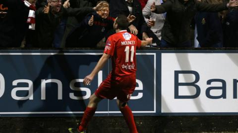 Substitute Tim Mouncey takes the acclaim of Portadown supporters after scoring an injury-time winner