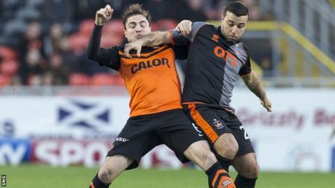 Paul Paton of Dundee United battles with Alexei Eremenko of Kilmarnock