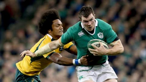 Henry Speight tackles Peter O'Mahony during a pulsating Test between Ireland and Australia