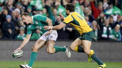 Ireland wing Tommy Bowe touches down for Ireland's second try as Adam Ashley-Cooper can only look on