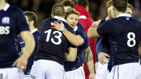 Scotland's Sean Lamont (left) and Chris Cusiter celebrate their win over Tonga.