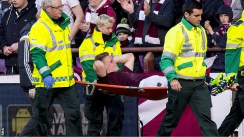 Kevin McHattie is stretchered off at Tynecastle