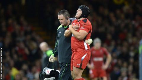 Wales prop Nicky Smith is helped off the field in pain