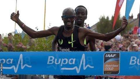 Mo Farah celebrates winning the Great North Run in Gateshead