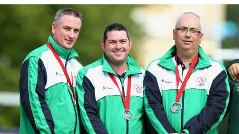 Paul Daly, Neil Mulholland and Neil Booth won silver in the Men's Triples bowls at the Commonwealth Games in Glasgow