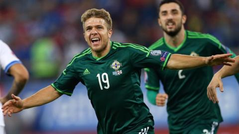 Jamie Ward found the net as Northern Ireland made it three wins from three qualifying games by beating Greece 2-0 in Athens