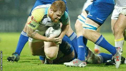Dan Baker is tackled in Dublin