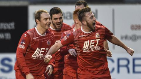 Portadown players run to congratulate Mark McAllister on scoring the opening goal in the 3-1 win over Glentoran