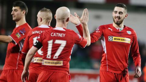 Joe Gormley celebrates with team-mates after scoring one of his three goals in Cliftonville's 7-0 win over Ballymena United