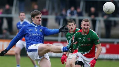Gary Boyle of Warrenpoint in action against Inniskeen's Robert Lorenz during the Ulster Intermediate Club Championship final