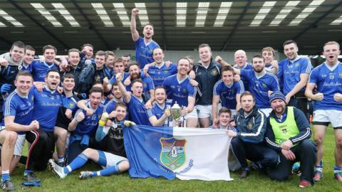 Smiles all round as the players of Warrenpoint pose for a happy team photo after winning the 2014 Ulster Intermediate Club Football Championship