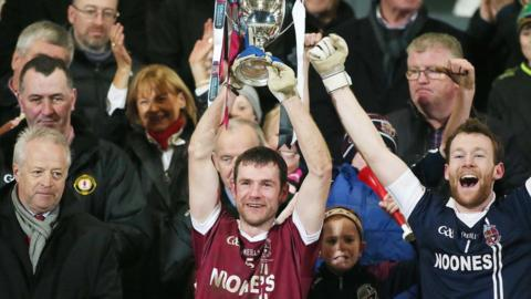 Slaughtneil skipper Francis McEldowney lifts the Seamus McFerran Cup after his side's one-point win over Omagh club St Enda's