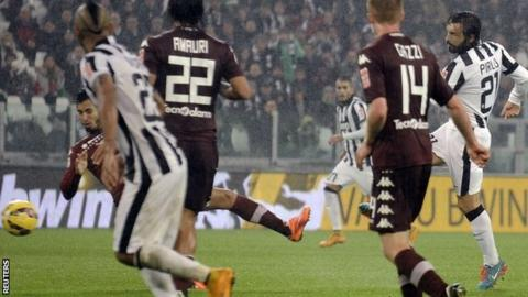 Andrea Pirlo scores Juventus' late winner in the derby against Torino