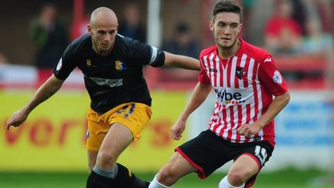 Adam Murray (left) in action against Exeter City this season