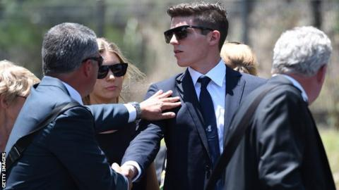 Sean Abbott, who bowled the ball that struck Phillip Hughes, is comforted as he arrives at Hughes's funeral