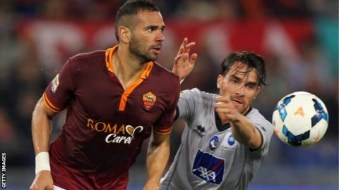 Roma defender Leandro Castan competes for the ball against Atalanta