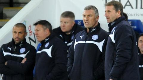 Nigel Pearson talks to his backroom staff against Liverpool