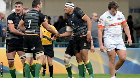 Luther Burrell (centre) is congratulated after scoring Northampton's fourth try