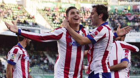Atletico Madrid's Jose Maria Gimenez (left) celebrates scoring the opening goal