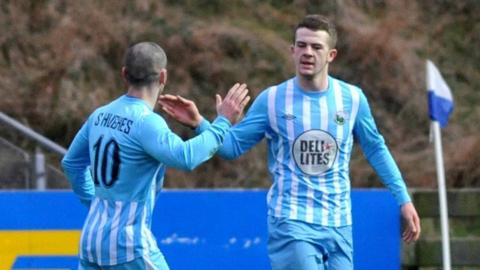 Stephen Hughes congratulates Ciaran O'Connor who scored for Warrenpoint Town in the 3-3 draw with Dungannon Swifts