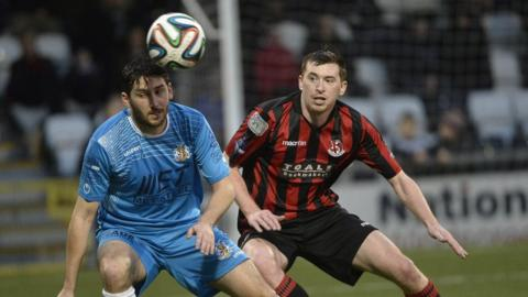 Portadown's Sean Mackle and Billy Joe Burns of Crusaders in action at Seaview