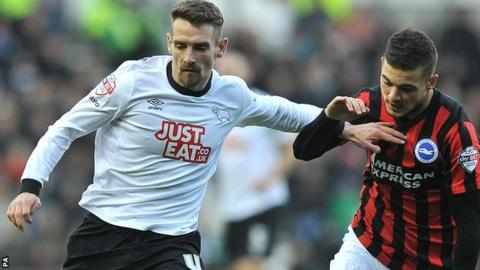 Craig Bryson (left) fends off Brighton's Jake Forster-Caskey