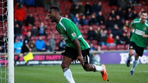 Worcester City striker Daniel Nti celebrates his equaliser against Scunthorpe United at Glanford Park