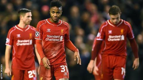 Liverpool players Raheem Sterling, Joe Allen and Jordan Henderson