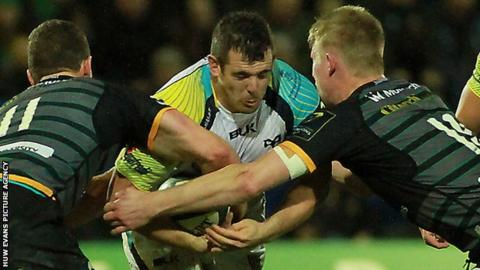 Aaron Jarvis tackled by George North (L) and James Craig (R)