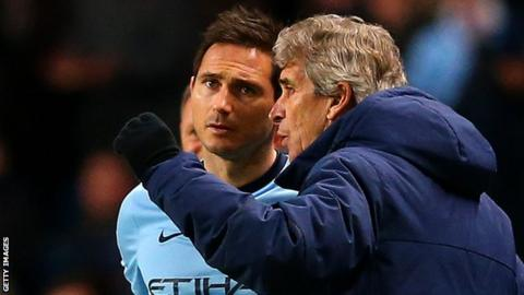 Manchester City manager Manuel Pellegrini (right) and midfielder Frank Lampard