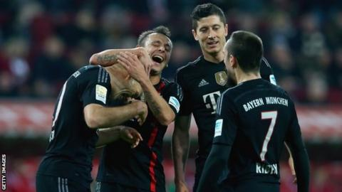 Bayern Munich players celebrate one of their four goals in the 4-0 win over Augsburg