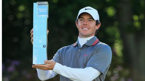 Rory McIlroy celebrates with the BMW PGA Championship trophy at Wentworth. He carded a six-under-par 66 final round to beat Thomas Bjørn, who started seven strokes clear of McIlroy on the final day in May.