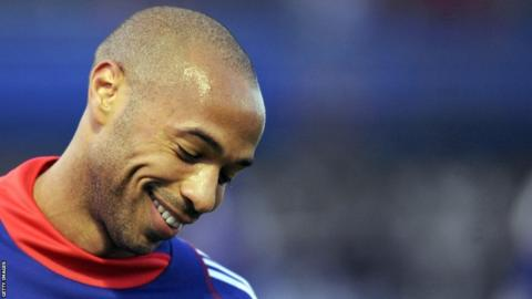 French national football team's captain Thierry Henry smiles while attending a training session, on November 11, 2009