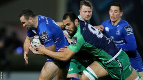 Leinster wing dave Kearney is tackled by Connacht's George Naoupu
