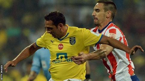 Kerala Blasters striker Michael Chopra (left) and Atletico Kolkata's Borja Fernandez