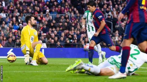 Barcelona striker Luis Suarez scores against Cordoba