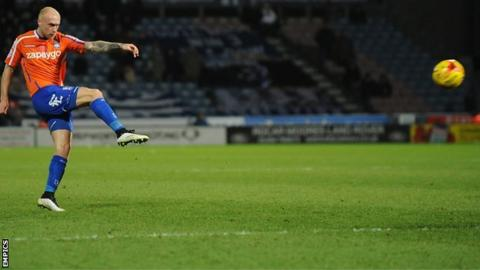 David Cotterill (left) scores the winner against Huddersfield
