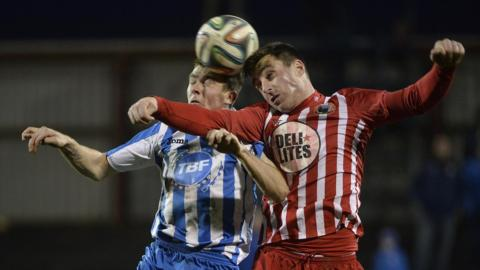 Ian Parkhill and John Doyle jump for the ball at the Coleraine Showgrounds