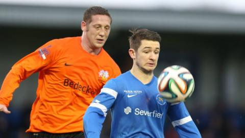 Kris Lindsay closes in on Liam Martin who holds up the ball for Ballinamallard during the Fermanagh side's 1-0 over Glenavon
