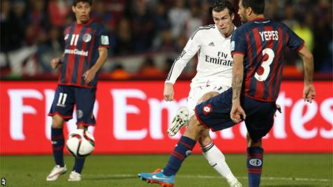Real Madrid forward Gareth Bale scores for his side against San Lorenzo