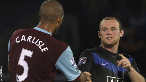 Carlisle shakes hands with Wayne Rooney after a game between Burnley and Manchester United