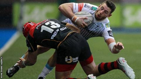 Tyler Morgan tackles Alex Cuthbert