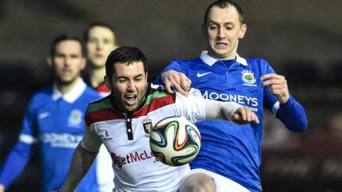 Glentoran's Niall Henderson and Linfield midfielder Sammy Morrow battle for possession in the Big Two showdown at Windsor Park